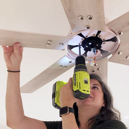 Woman removing the fan's blades.