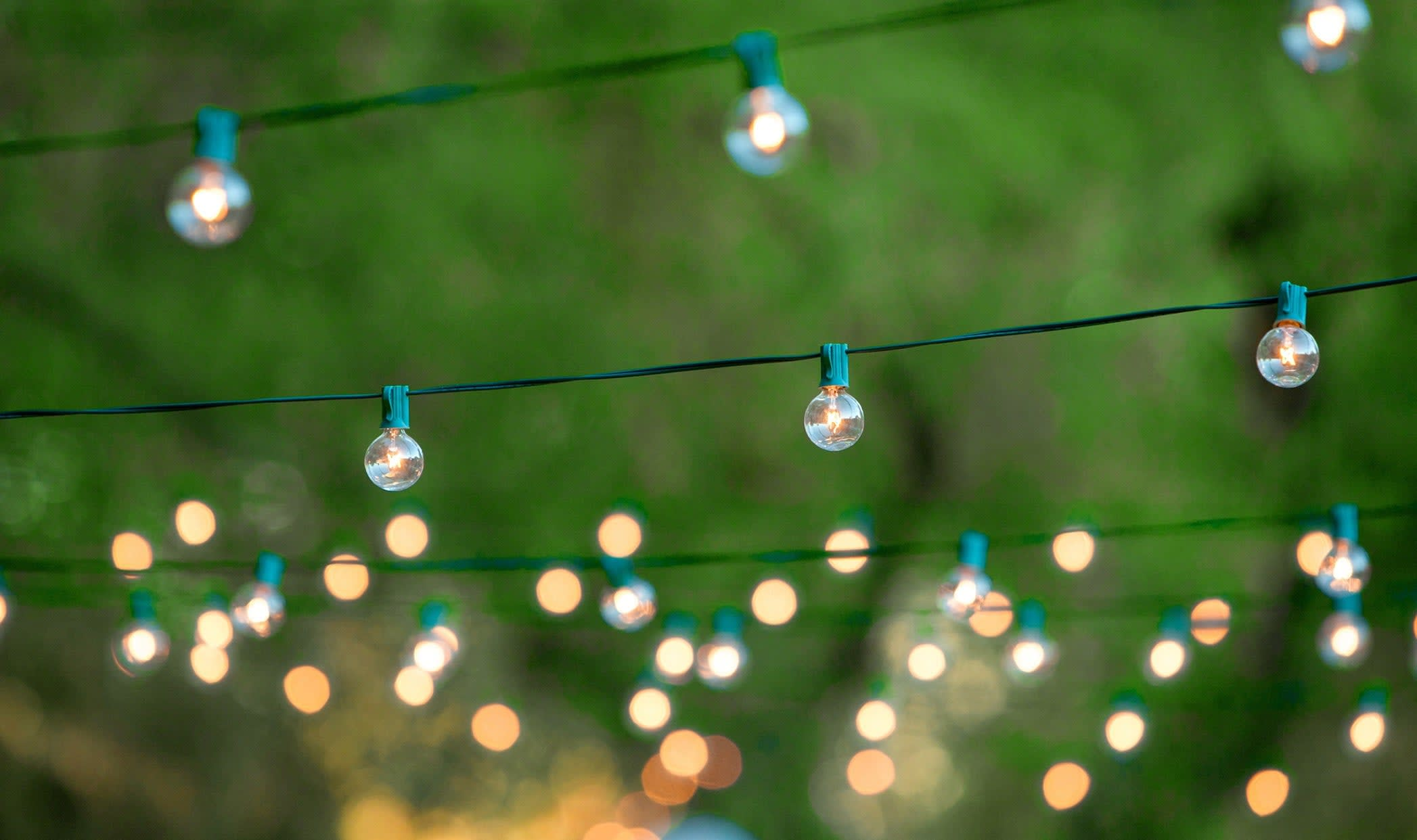 string of lights decorating an outdoor patio