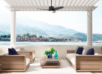 Ceiling fan hanging on a white pergola near the water